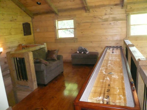 Shuffle-Board-electronic-dart-board-on-loft-with-twin-sleeper