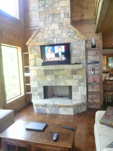 Stone-fireplace-with-wide-screen-high-def